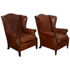 French Pair of Chestnut Leather Wing Chairs, Second Quarter of the 20th Century