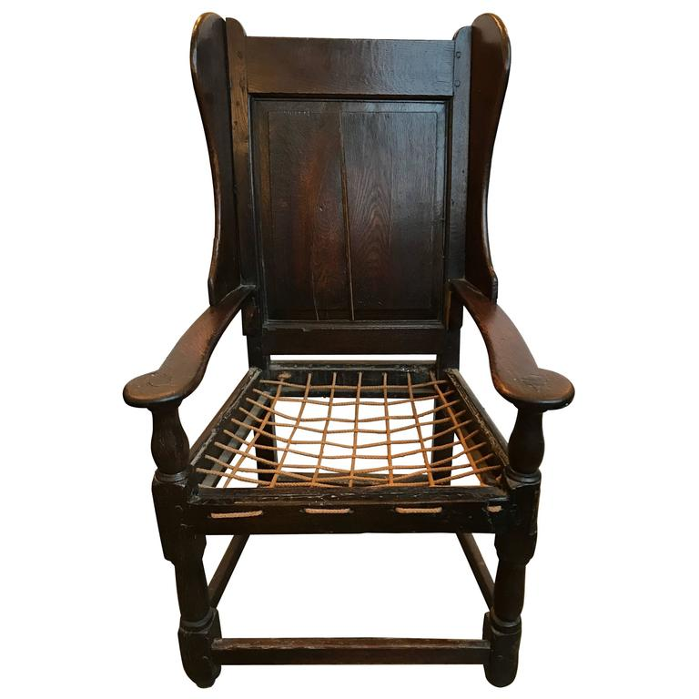 18th Century English Oak Wing Chair with Rope Seat