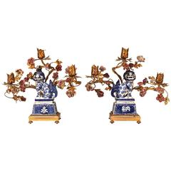 Pair of French Bronze Candelabra with Chinese Porcelain Foo Dogs