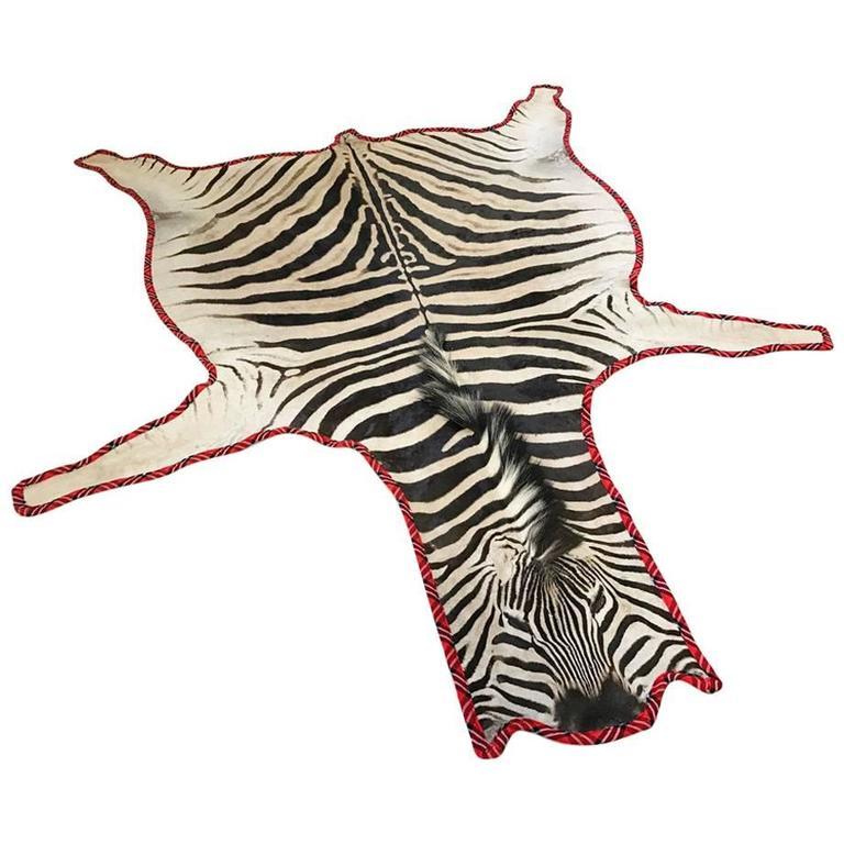 Zebra Hide Rug Trimmed in Maasai Warrior Blanket