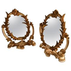 Two Venetian Parcel-Gilt Easel Mirrors