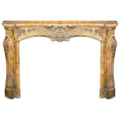 Sculpted Louis XV Style Fireplace in Yellow Marble
