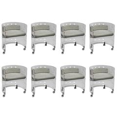 Set of eight Lucite Swiveling Chairs by Luciano Di Pilla