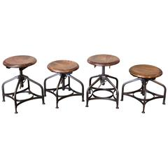 Set of Four Vintage Industrial Adjustable Toledo Wood and Metal Shop Stools