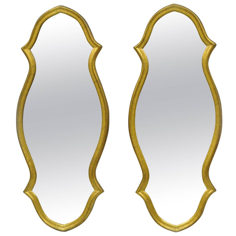 Pair of Vintage Carved Wood Hollywood Regency Gold Keyhole Frame Wall Mirrors For Sale