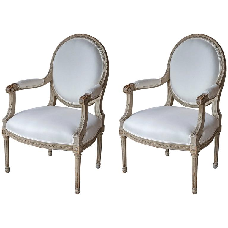 Pair of 19th Century Oval Back Fauteuils in the Louis XVI Style For Sale