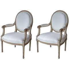 Pair of 19th Century Oval Back Fauteuils in the Louis XVI Style