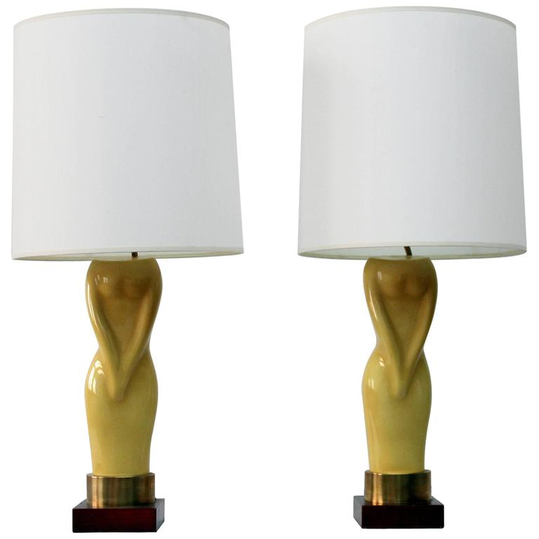 Pair of Womens Figural Yellow Lamps with White Shades
