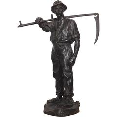 Bronze Statue of a Farmer Heading to the Field by Hans Muller