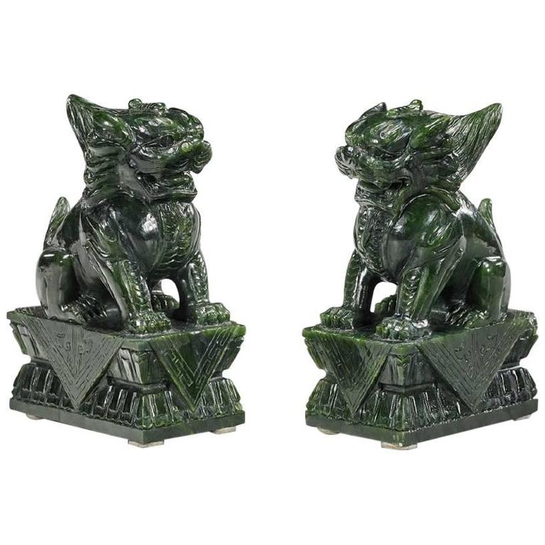 Pair of Chinese Carved Lion Sculptures in Spinach Jade on Lotus Pedestal