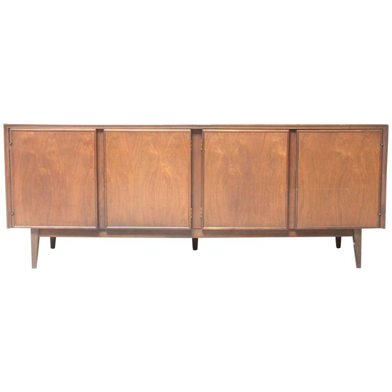 Mid century low walnut credenza by american of for Mid century american furniture