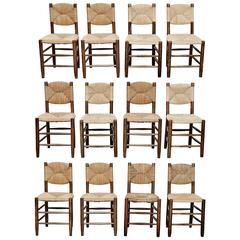 Dining Set of 12 Chairs by Charlotte Perriand, circa 1950