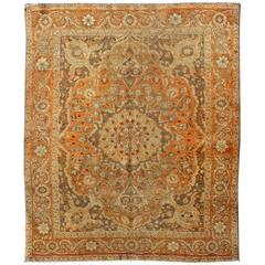 Antique Perisan Tabriz Haji Jalili with Ornate Central Medallion and Florals