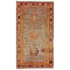 Central Asia Antique Khotan Rug with Floral Geometrics