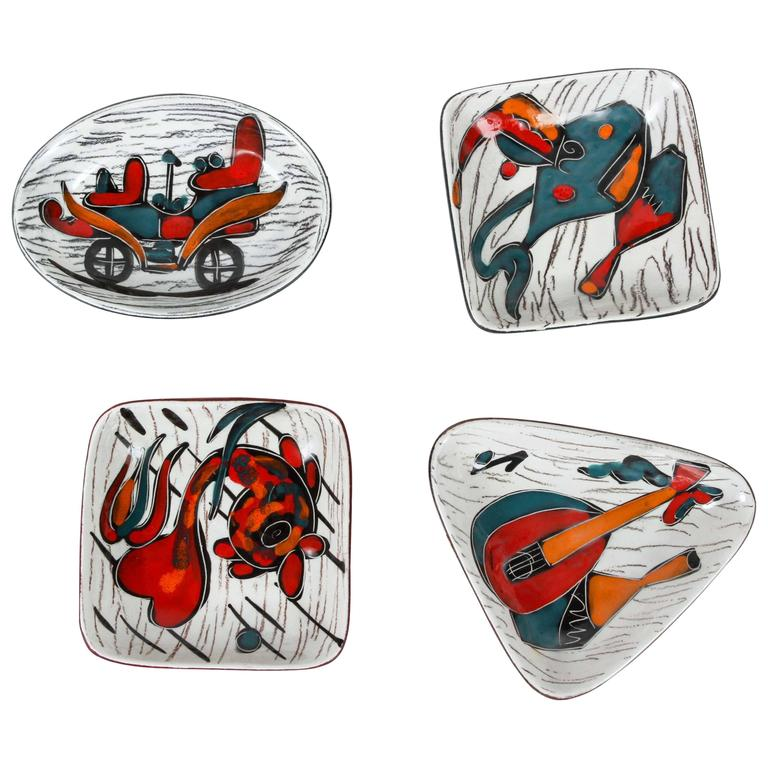 Four Italian Leather Backed Decorative Ceramic Dishes