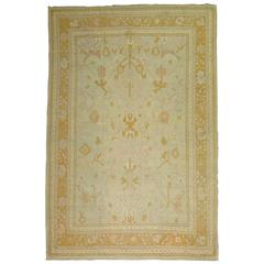 Antique Oushak Rug with Pink Hues