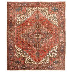 Vintage Persian Heriz Carpet with Geometric Medallion in Rust and Denim Blue