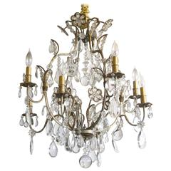 Hollywood Regency Gilt Decorated Wrought Iron and Crystal Eight-Arm Chandelier
