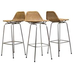 Set of Three Charlotte Perriand Style Rattan and Chrome Bar Stools