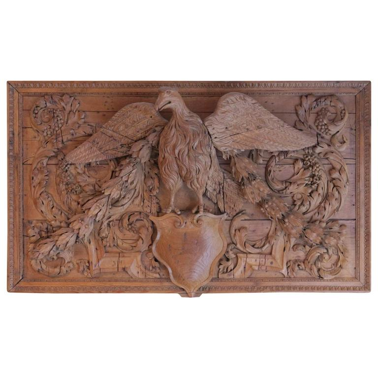 Open Wings Oak Eagle Seated on a Coat of Arms in a Wall Panelling