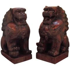 Pair of Cinnabar Lacquered Carved Wood Foo Dogs