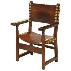 17th Century Spanish Walnut and Leather Armchair with Oversized Brass Nailheads