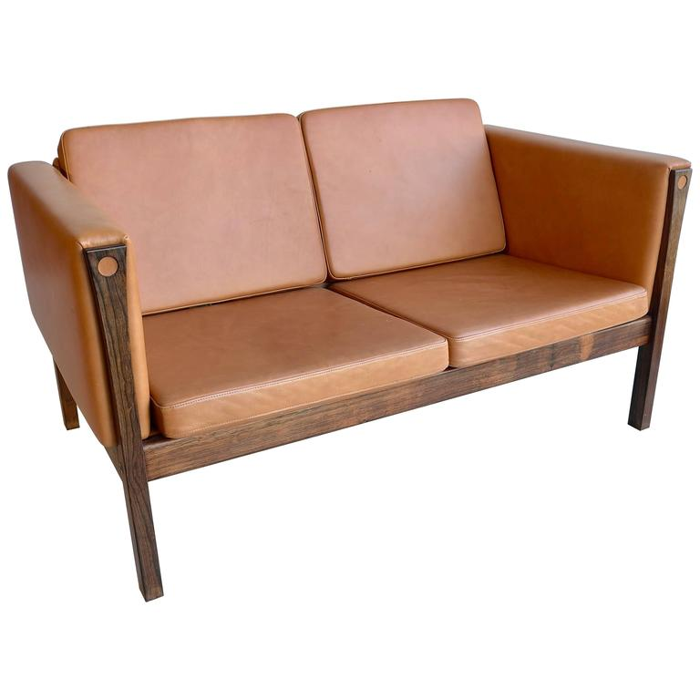 hans wegner two seat sofa ap62 in cognac leather and rosewood denmark 1965 for sale at 1stdibs. Black Bedroom Furniture Sets. Home Design Ideas