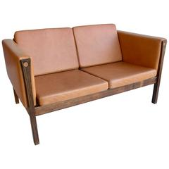 Hans Wegner Two-Seat Sofa AP62 in Cognac Leather and Rosewood, Denmark, 1965