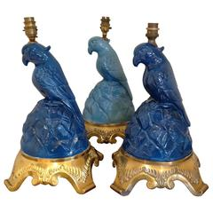 Set of Three Fabulous Glazed Blue Porcelain Parrot Lamps on Gilt Bronze Mounts
