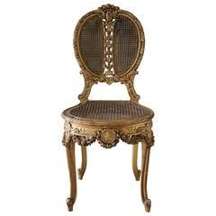 19th Century Louis XV Style Cane and Carved Giltwood French Chair