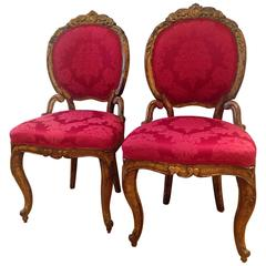 Pair of 18th Century Italian Baroque Giltwood Chairs Upholstered in Damask