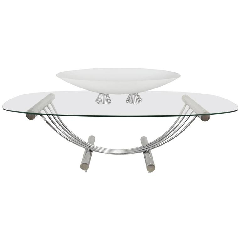 Mid century modern tubular chrome oval glass coffee table with center piece for sale at 1stdibs One piece glass coffee table