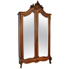 Late 19th Century French Louis XV Style Mirrored Walnut Armoire