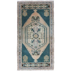 Small Turkish Oushak Carpet with Dark Green Field, Soft Lavender Floral Border