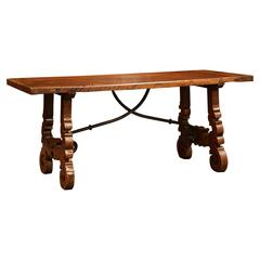 Mid-20th Century Spanish Carved Walnut Coffee Table with Iron Stretchers