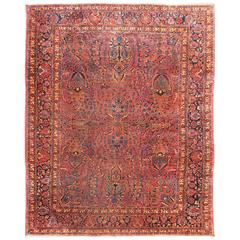 Antique Persian Sarouk Carpet with Deep Cranberry Field and Floral Elements