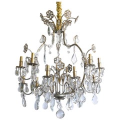 Hollywood Regency Gilt Decorated Wrought Iron and Crystal Twelve-Arm Chandelier