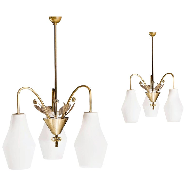 Pair of Chandelier by Paavo Tynell For Sale