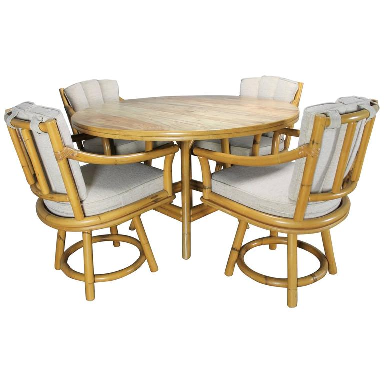 Mid-Century Ficks Reed Co. Round Rattan Game Table with Four Swivel Armchairs For Sale