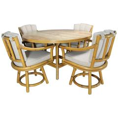 Mid-Century Ficks Reed Co. Round Rattan Game Table with Four Swivel Armchairs