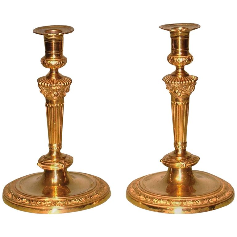 Pair of Louis XVI Style Ormolu Candlesticks with Lion's Head Decoration