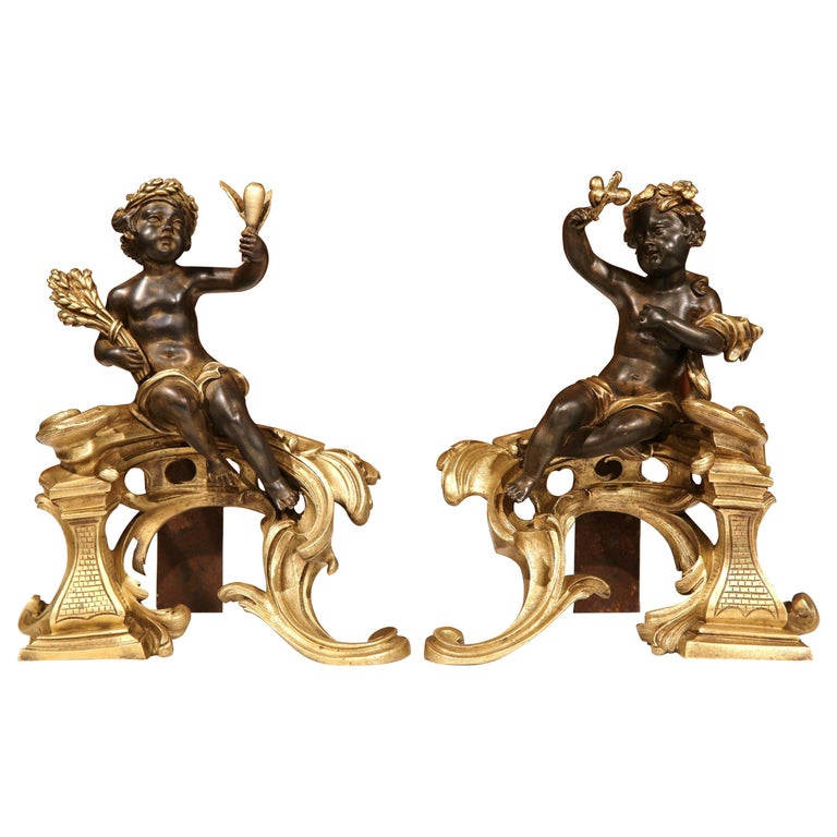 Pair of 19th Century French Patinated Bronze Andirons Chenets with Cherub Motif For Sale