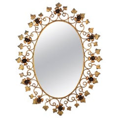 Wrought Gilt Iron Oval Mirror with Floral and Leaf Motifs, Spain, 1950s
