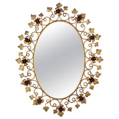 1950s Spanish Hand-Hammered Floral Gilt Iron Oval Mirror