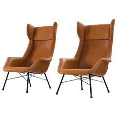 Lounge Chairs in New Leather Upholstery by M. Navratil