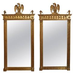 Pair of Classical Style Giltwood Mirrors with Carved Eagles