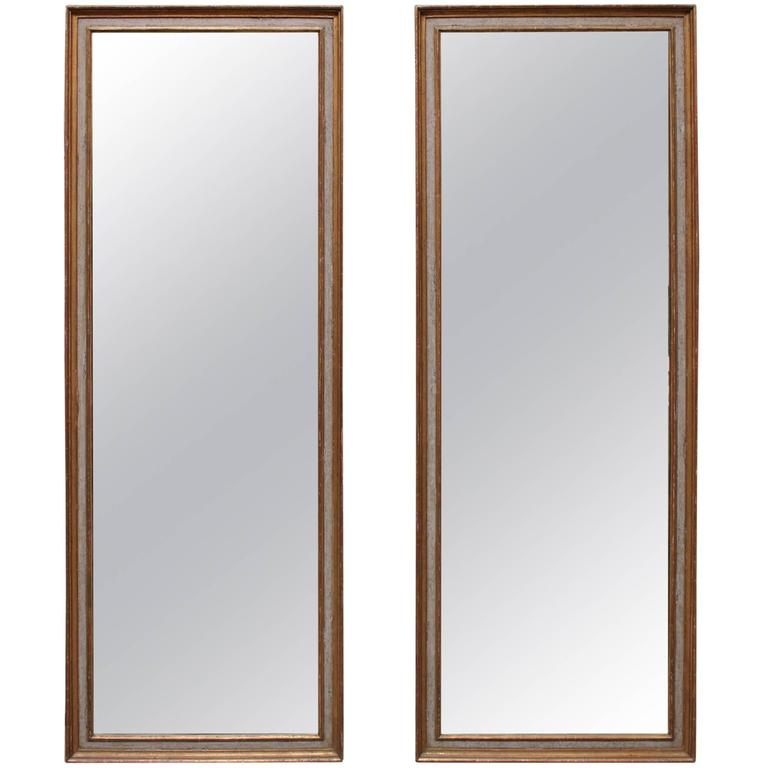 Pair of Neoclassical Style Mirrors with a Painted and Parcel Gilt Finish