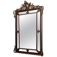 Antique French Gold Leaf and Ebonized Paneled Mirror