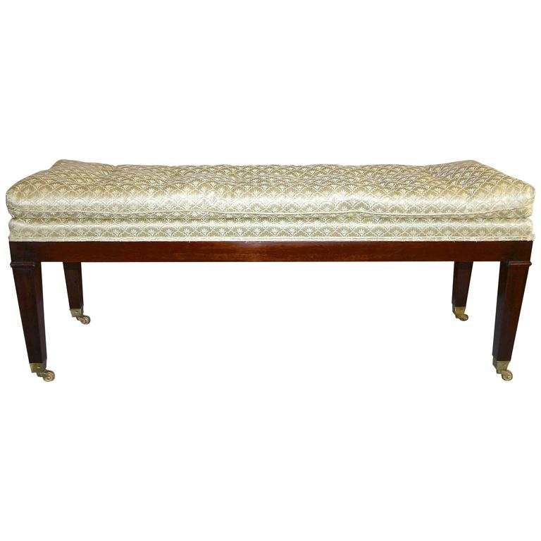 Upholstered mahogany long bench with brass casters for sale at 1stdibs Long upholstered bench