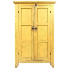 19th Century New England Chrome Yellow Cupboard with Panelled Doors